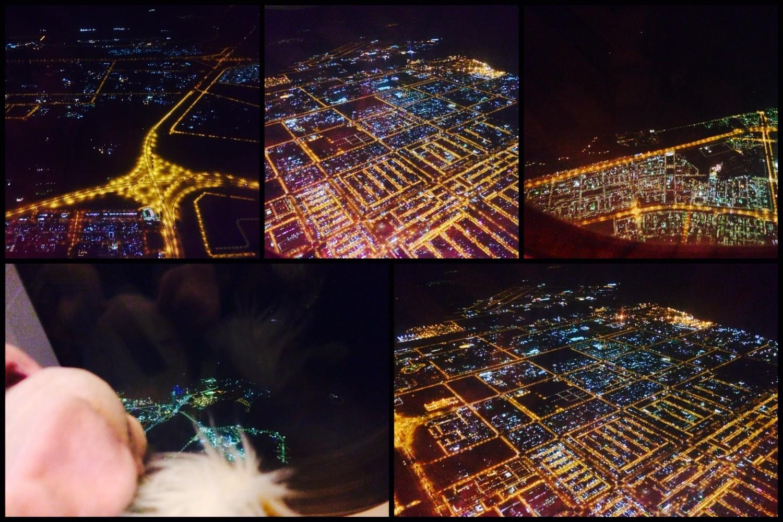 Hoch in den Wolken, unter uns Abu Dhabi.