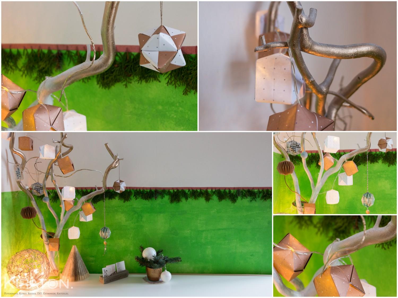 Adventsdeko und Tannengrün an der Wand.